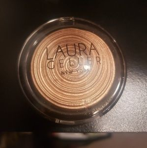 Laura Geller illuminator in Guilded Honey
